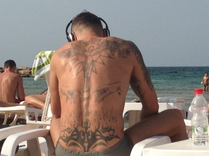 Hilton - Some guy with a tattooed back